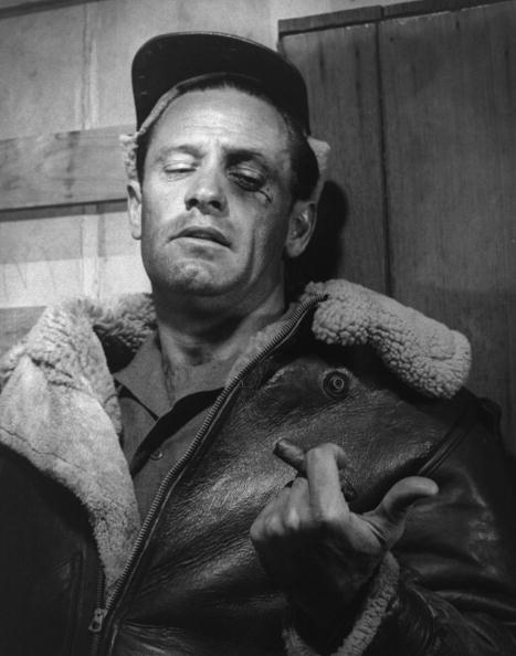 William Holden in leather jacket, with black eye and cigar, during filming of Stalag 17. (Photo by John Swope/The LIFE Images Collection/Getty Images)